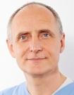 Portrait Dr. med. dent. Volker Ludwig, Zahnarztpraxis Dr. Ludwig und Kollegen MVZ GmbH, Fürth, Zahnarzt, Implantologie: Knochenaufbau, Kinderzahnheilkunde, Endodontie (Mikroskop)